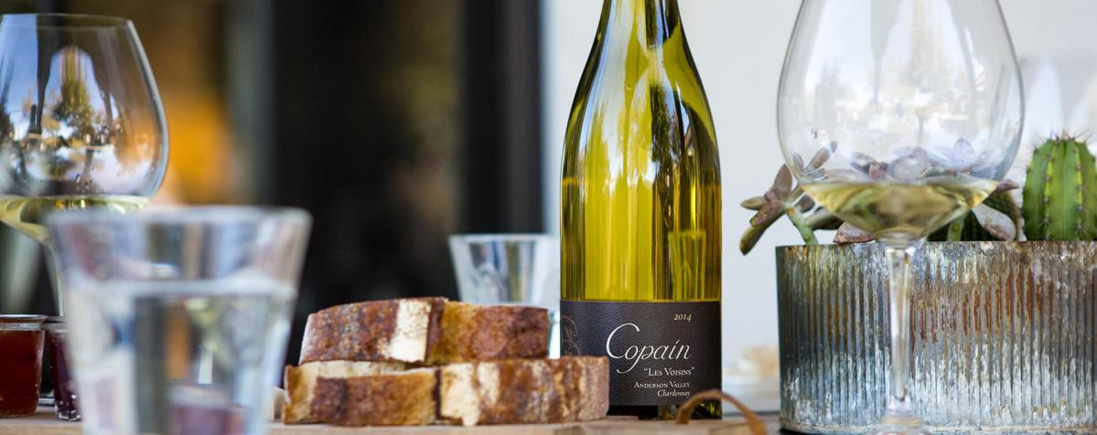 Copain bottle next to some bread slices